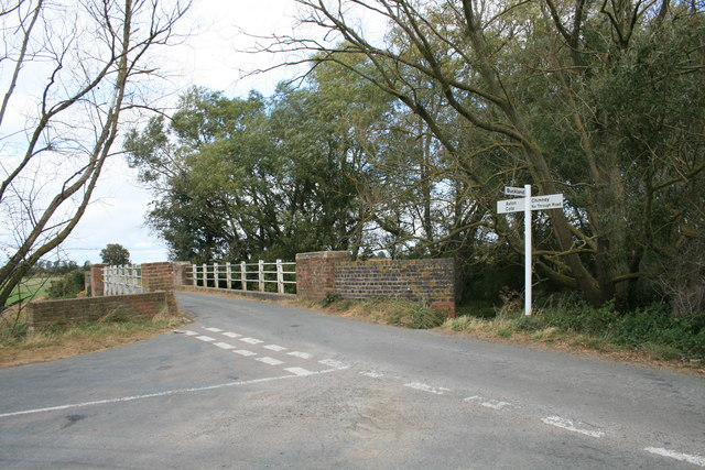 Road junction by a bridge over the Great Brook