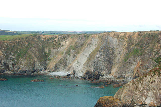 Crumbling cliffs and landslips west of Dinas Fawr