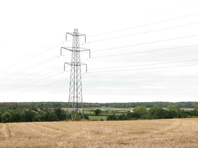 Electricity pylon in stubble field