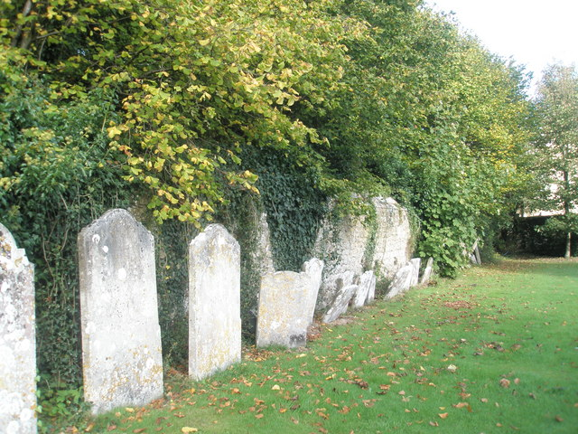 Gravestones by the churchyard wall at St George's, Trotton
