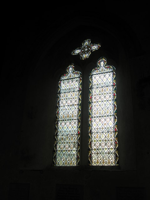Stained glass window near the font at St George's, Trotton