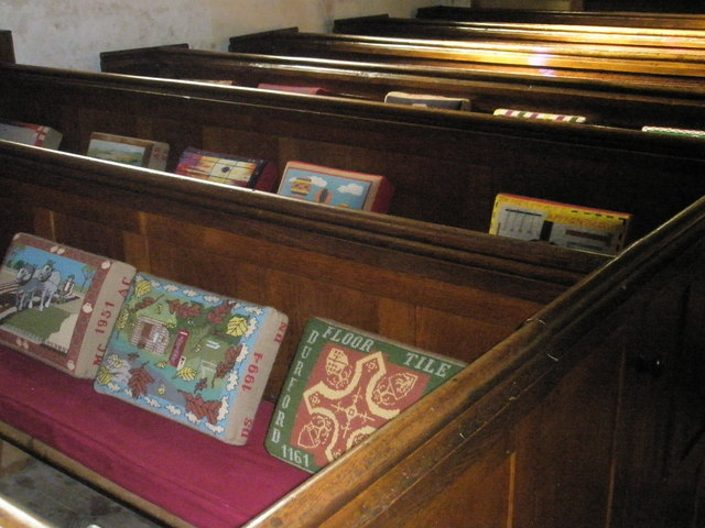 Kneelers and pews within St George's, Trotton