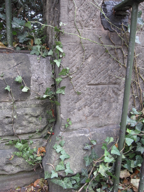 Bench mark on Overleigh Cemetery stone post