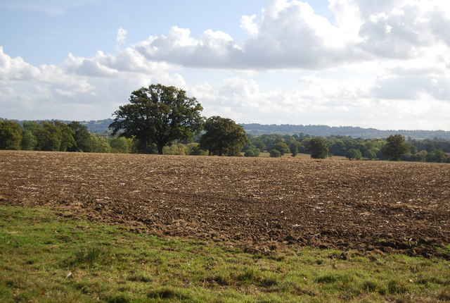 The view south across a large ploughed field