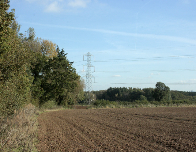 2009 : Ploughed field and pylon, Kington Langley