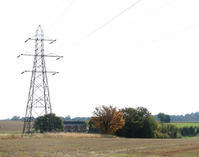 View across stubble to a house on White Heath Road