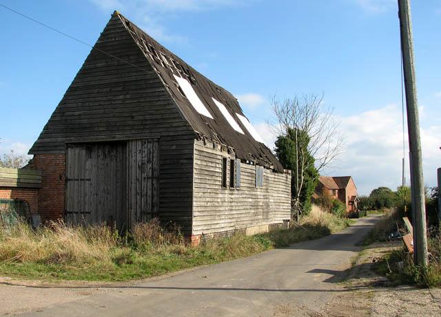 Dodgers Lane past old barn by Church Farm