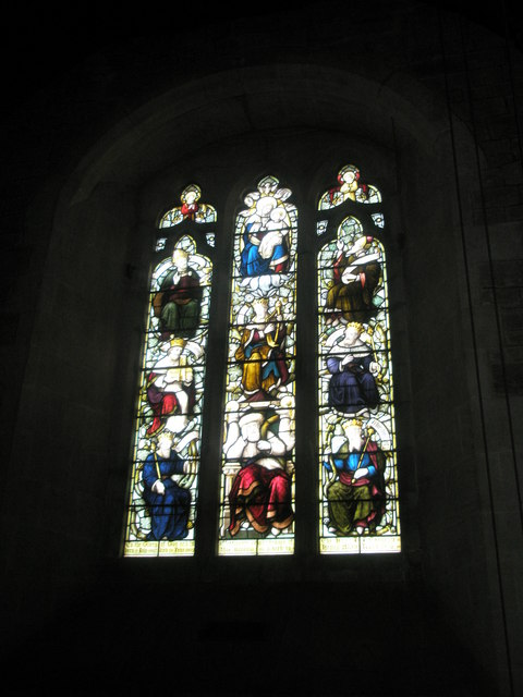 Stained glass window on the west wall  at St Bartholomew, Rogate