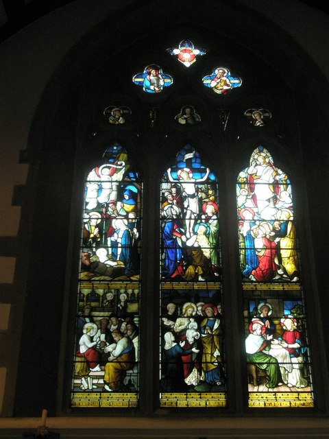 Stained glass window above the altar at St Bartholomew, Rogate