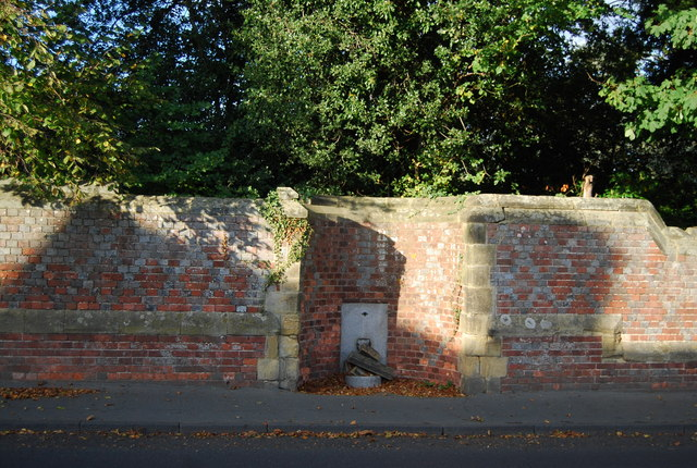 Disused water fountain, wall of Hall Place, Leigh