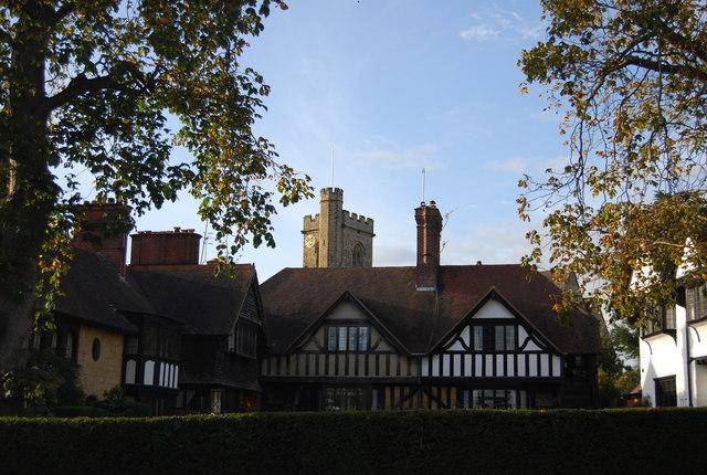 Half timbered house & church tower, Leigh