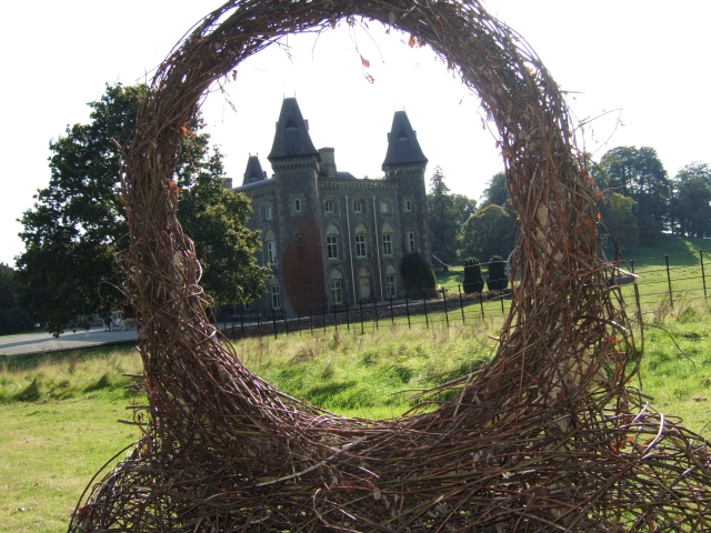 An artwork at Dinefwr Park with Newton House beyond