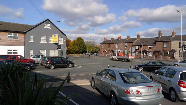 Finney Lane (left) meets Wilmslow Road
