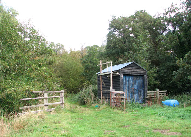 Hut by gate into a pasture