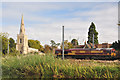 TL2166 : St Peter's church and freight train - Offord D'Arcy by Mick Lobb