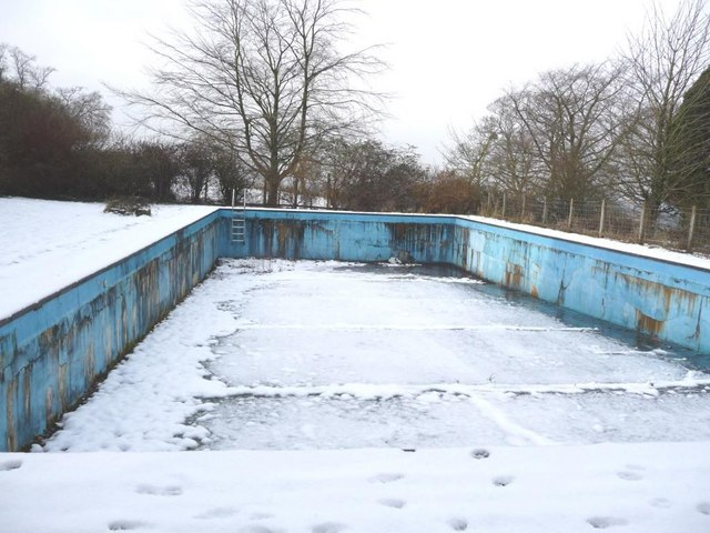 Snow covers the empty swimming pool christine johnstone for Empty swimming pool