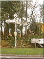 SY8381 : West Lulworth: old signs at Burngate by Chris Downer