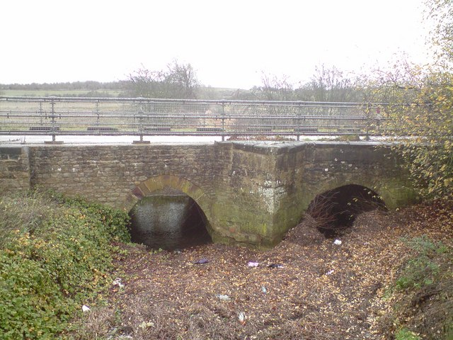 Old A508 road bridge over River Tove drainage channel
