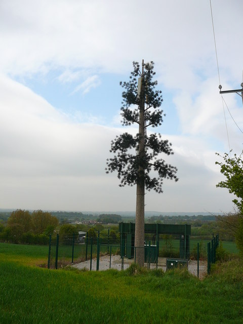 Mobile phone mast disguised as an artificial tree