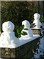 SE2537 : 3 small snowmen on a wall, Outwood Lane, Christmas Day : Week 51