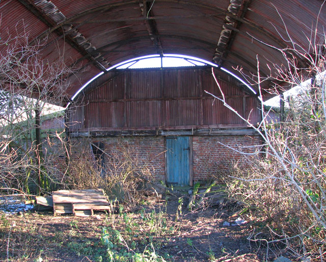 Inside a dilapidated farm shed