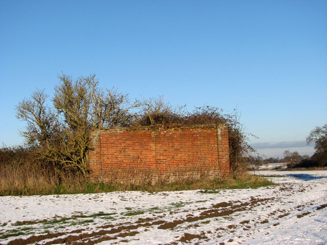 Remains of a brick barn beside farm track