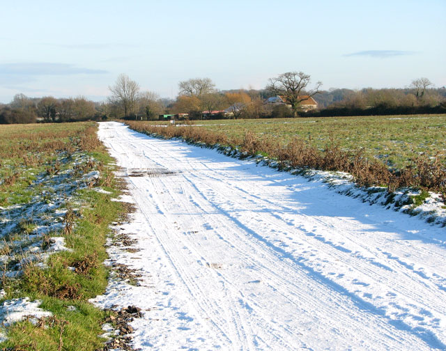 Snowy road to Hales Green
