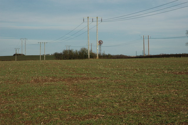 Power lines and a wind pump