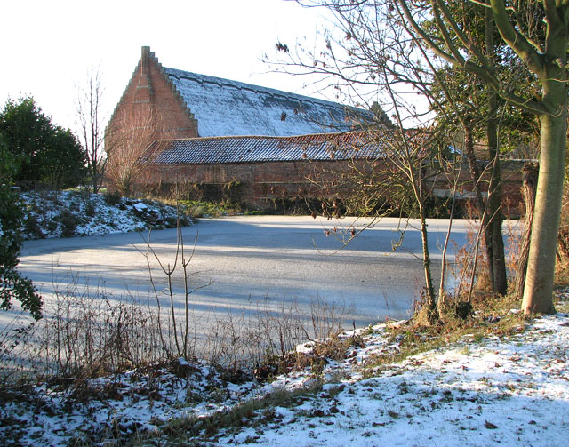 Frozen pond by Hales Great Barn