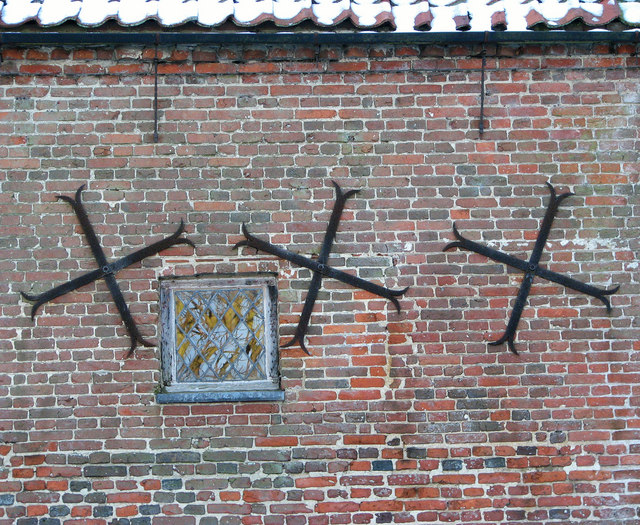 Brackets in north wall of Hales Hall