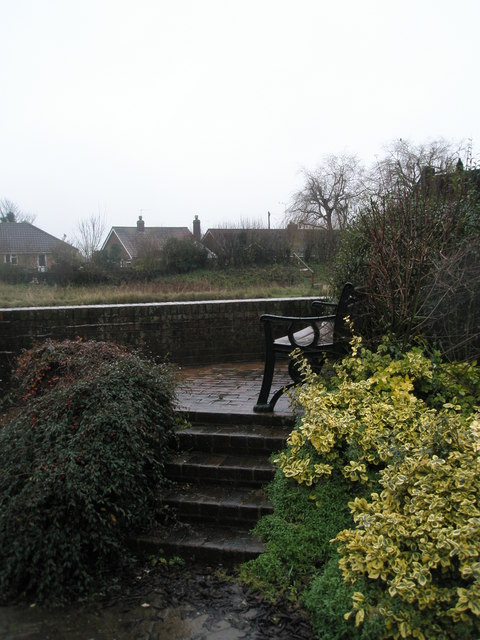 Steps up to a seat overlooking the River Arun