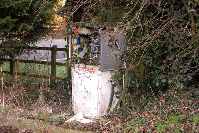 Disused DERV pump by old grain store, Staverton
