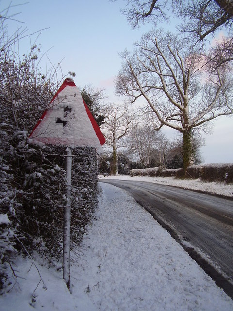 Snowy road sign