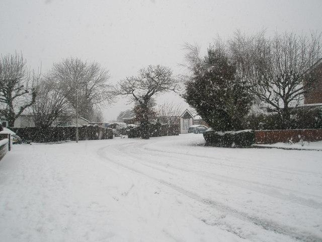 Bend in a snowy Hooks Lane
