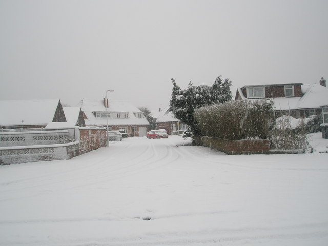 Looking from a snowy Talbot Road into Talbot Close