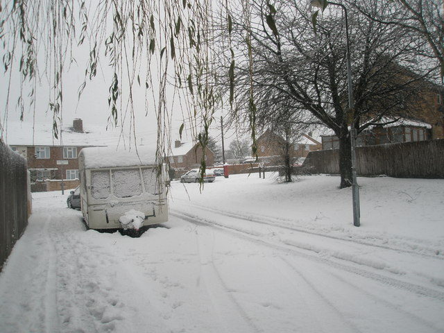Approaching the junction of a snowy Ibsley Grove and Hooks Farm Way