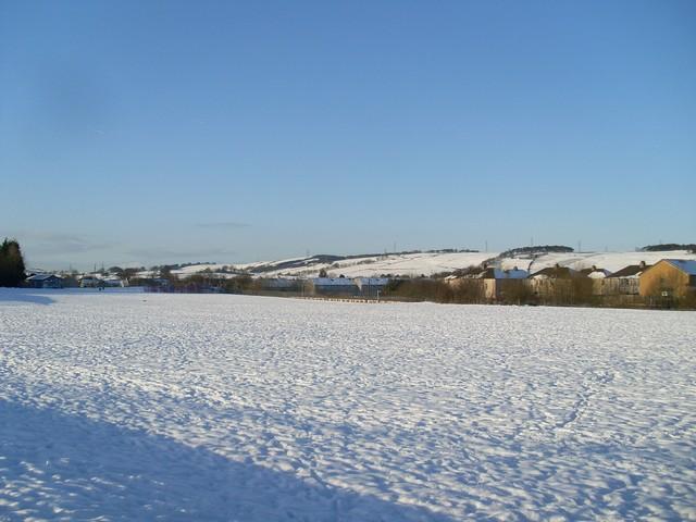 Across playing fields in Neilston