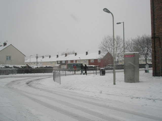 Approaching the junction of  a snowy Hazleholt Drive and Barncroft Way