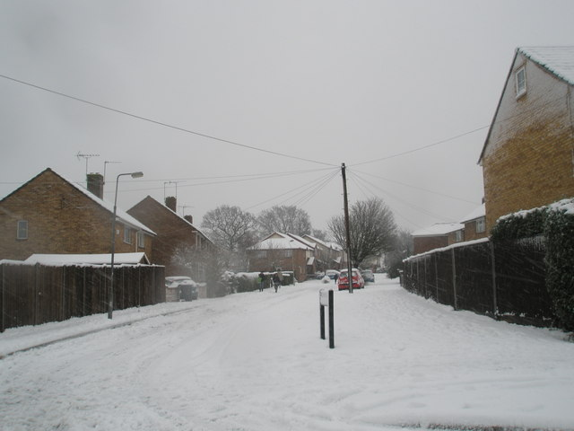 Looking from Hazleholt Drive into a snowy Burgate Close
