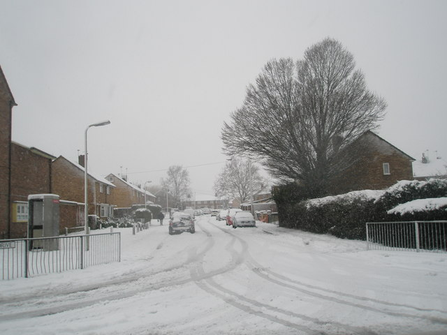 Looking from Barncroft Way into a snowy Hazleholt Drive