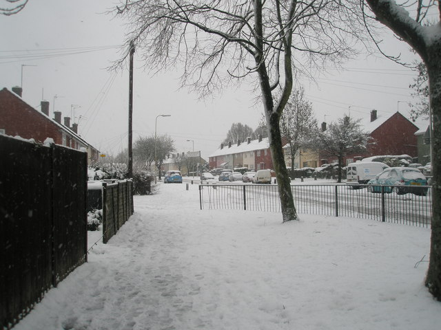 Approaching the junction of  a snowy Barncroft Way and Priorsdean Crescent
