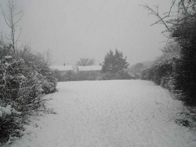Snow covered field behind Barncroft Way