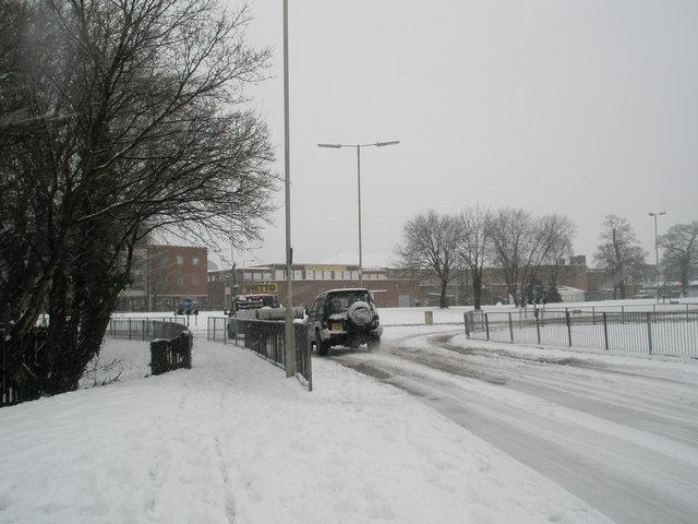 Approaching a snowy Central Roundabout from Stockheath Lane