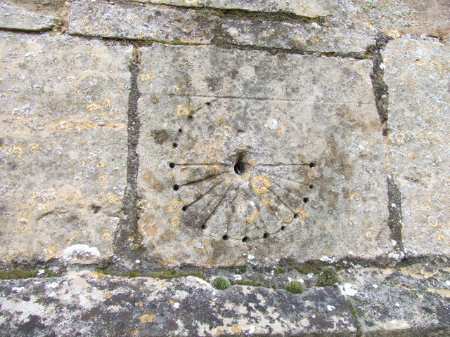 Scratch or mass dial on church porch