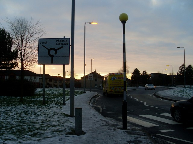 Road sign on approach to roundabout
