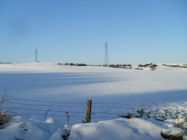 Power lines cross the Renfrewshire countryside