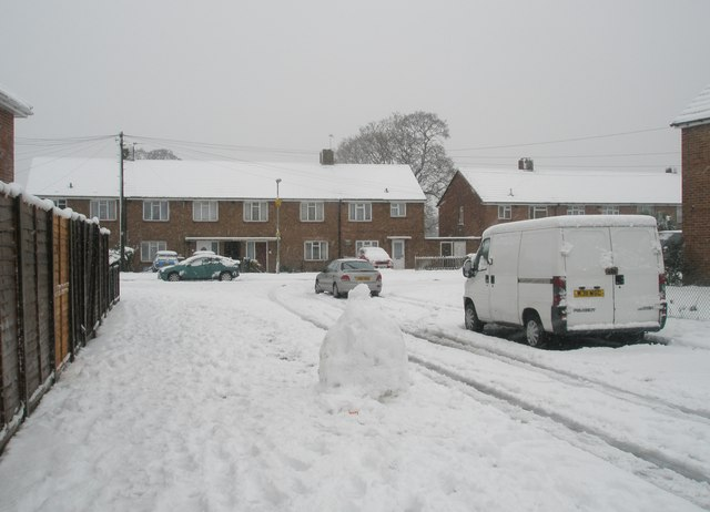 Approaching the junction of  a snowy Kingsworthy Road and Blendworth Crescent