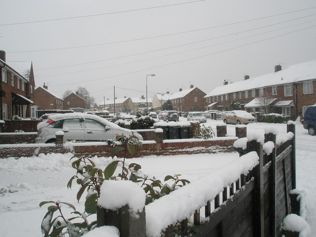 Looking across a snowy garden towards Blendworth Crescent
