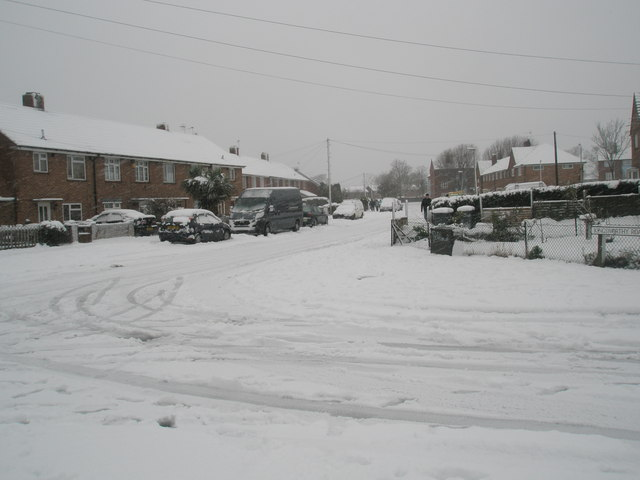 Junction of a snowy Kingsworthy Road and Blendworth Crescent
