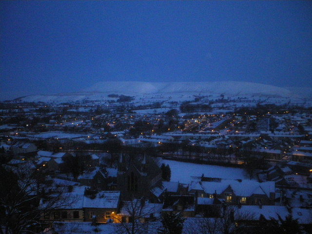 Clitheroe and Pendle in fast fading light.